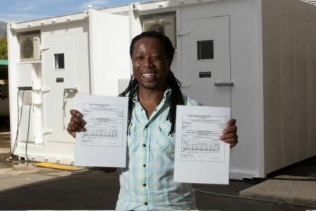 Figure 5: Dr. Thato Mtshali holding certified certificates for two trace metal clean container laboratories.