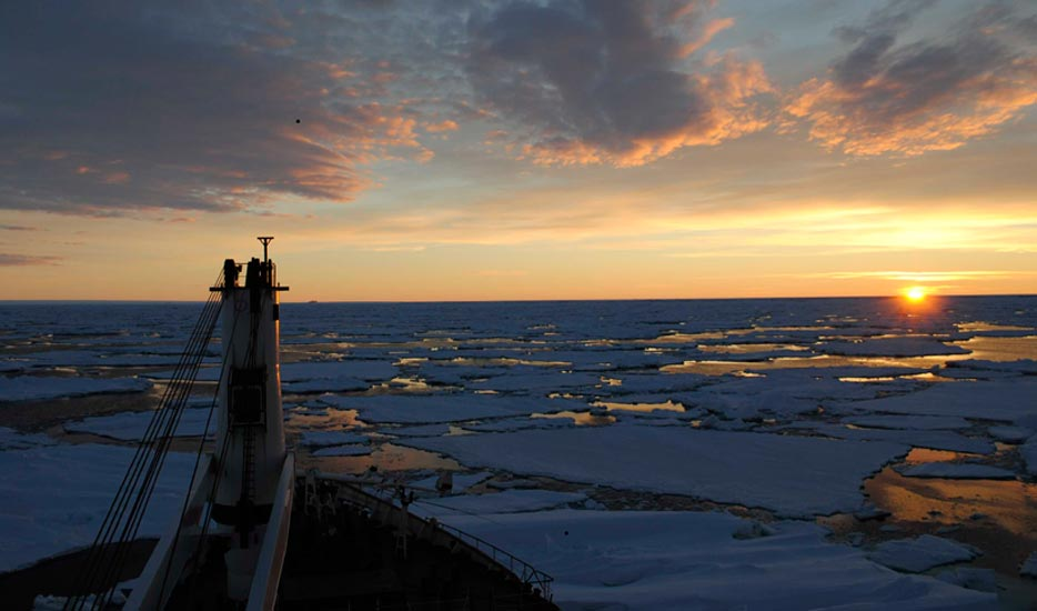 Sunset: A sunset over icy seas photographed from the MV SA Agulhas in Anarctica