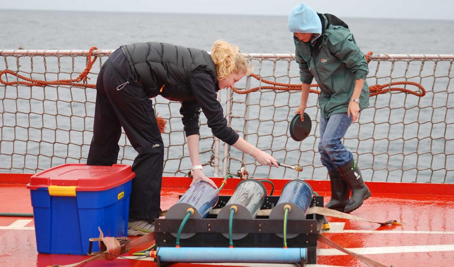 Incubations: Oceanographic scientists Samantha Maxwell-Hafen (left) and Fiona Preston-Whyte (right) incubating water samples for phytoplankton primary production measurements on board the MV SA Agulhas in Antarctica.